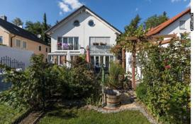 Houses for sale in Germany. Bright house with a terrace, a winter garden and a plot with a summer house, Munich, Bavaria, Germany