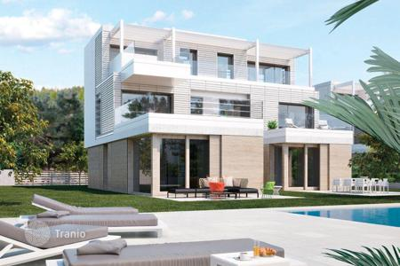 Coastal townhouses for sale in Catalonia. Premium townhouse on the first line to the sea in Gavà Mar, Spain