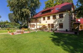 Luxury 6 bedroom houses for sale in Central Europe. Spacious villa with a guest apartment, a garden and a garage in the prestigious area of Pullach im Isartal, Munich, Germany