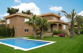 4 bedroom houses for sale in Barcelona. Spacious villa with a landscape garden, a swimming pool, terraces and a garage, Sant Pol de Mar, Spain
