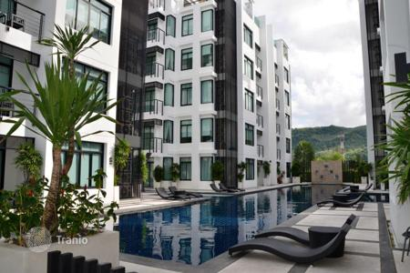 Coastal residential for rent in Phuket. Furnished two-bedroom apartment in a modern complex with swimming pools, a restaurant and garden close to Kamala Beach, Phuket