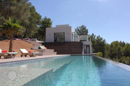 Houses with pools for sale in Sant Josep de sa Talaia. Exquisite, stunning minimalist Villa situated in one of the most exclusive areas of Ibiza, enjoys breathtaking sea views