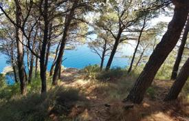 Coastal development land for sale in Croatia. Spacious plot of land for building with water, electricity and a sea view, near the beach, Omis, Croatia
