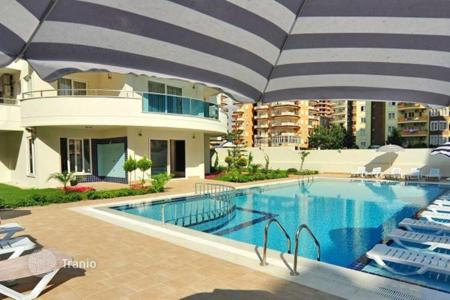 Cheap apartments with pools for sale in Western Asia. Urgent sale! Fully furnished apartment with a balcony. The complex with developed infrastructure, only 200 m from the sea. Alanya, Turkey