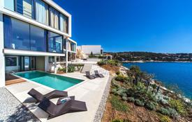 Houses for sale in Primošten. Complex of new villas and apartments with premium finishes, swimming pools, gardens, garages and a private beach, Primošten, Croatia
