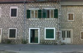 4 bedroom houses for sale in Kotor (city). Sea front old stone semi detached house in Muo/Kotor municipality. Beautiful spacious house with panoramic sea views