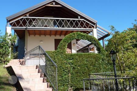 3 bedroom houses for sale in Europe. The newly built villa overlooking the lake Maggiore, a private garden, garage and swimming pool in the city of Ghiffa, Italy