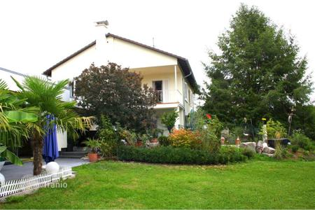 Houses with pools for sale in Schopfheim. Representative villa with with a koi pond in Schopfheim