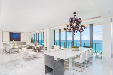 4 bedroom apartments for sale in North America. Luxury apartment with panoramic windows, a terrace overlooking the ocean in a condominium with pool, Sunny Isles Beach, Florida, USA