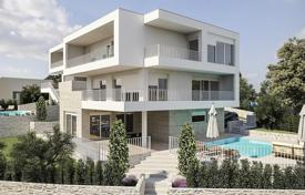 4 bedroom houses for sale in Sibenik-Knin. Villa with a garden, a swimming pool and a parking, 50 meters from the sea, Rogoznica, Croatia