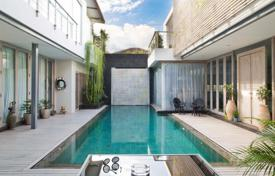 Property for sale in Bali. Modern villa with a swimming pool, a garden and a garage, near the beach, Seminyak, Bali