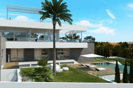 Luxury 6 bedroom houses for sale in Majorca (Mallorca). Contemporary villa with garden, terrace, 2 pools and stunning sea view in Nova Santa Ponsa, Mallorca, Balearic Islands, Spain