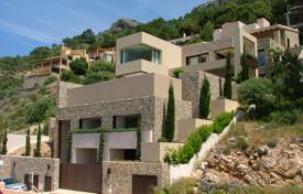 Luxury houses with pools for sale in Spain. Villa with a facade from natural stone, an elevator, a swimming pool, a garden and a beautiful sea view, Costa de Canyamel, Mallorca
