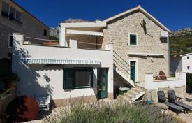 Coastal houses for sale in Split-Dalmatia County. Villa with a guest house, a private garden, a barbecue, terraces and a sea view, Makarska, Croatia