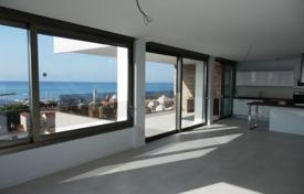 Apartments with pools by the sea for sale in Valencia. Stylish apartment with a terrace and a sea view, in a residential complex near the beach, Costa Blanca, Alicante, Spain