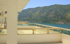 Apartments with pools by the sea for sale in Kindness. Spacious apartment in development with pool in Kotor Bay