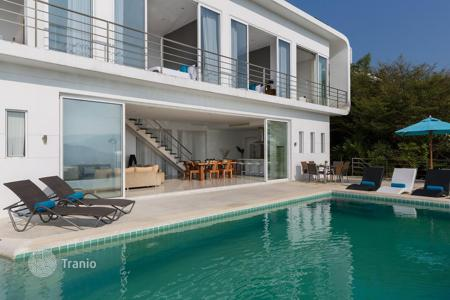Residential for sale in Thailand. Snow white villa with pool and panoramic view of the city and ocean on the island of Koh Samui, Thailand
