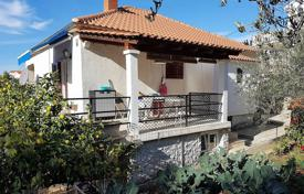 4 bedroom houses for sale in Split-Dalmatia County. Furnished villa with a private garden, a garage, terraces and a sea view, Milna, Croatia