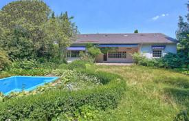 6 bedroom houses for sale in Bavaria. Cozy villa with a private garden, a swimming pool, a garage, a wine cellar and a winter garden, Starnberg, Germany