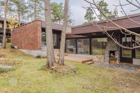 Coastal residential for sale in Espoo. Comfortable townhouse with a sauna, a swimming pool and panoramic windows, surrounded by a picturesque natural landscape, Espoo, Finland