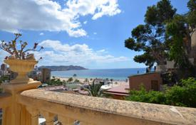 Luxury villas and houses with pools for sale in Costa Blanca. Exclusive four-level villa on the beach of Poniente in Benidorm, Spain