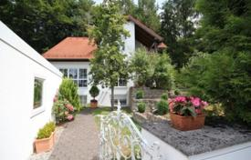 3 bedroom houses for sale in Bavaria. Spacious villa with a private garden, a garage and a guest apartment, near the lake, Starnberg, Germany