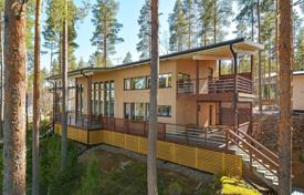 Property for sale in Finland. Modern designer cottage with a sauna and a garage, on a plot with pinewood, a sand beach and a mooring, Luopioinen, Finland
