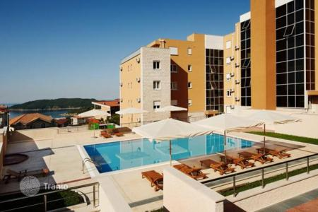 Apartments with pools for sale in Becici. The apartment is in a comfortable complex with swimming pool in Becici