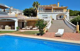 3 bedroom houses for sale in Costa del Sol. Furnished villa with a private garden, a pool, a garage, a terrace and sea and mountain views, Benalmadena, Spain