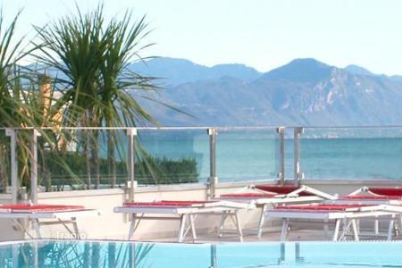 Apartments with pools for sale in Garda. Apartment – Garda, Veneto, Italy