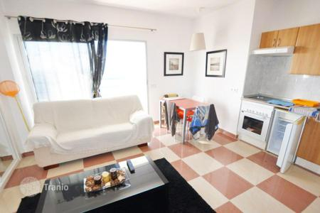 Cheap residential for sale in Adeje. Apartment with a balcony and a view of the ocean, Playa Paraiso, Tenerife, Spain
