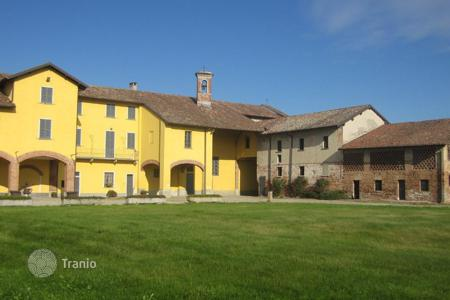 Luxury houses with pools for sale in Lombardy. Medieval manor with mansion, farm, chapel and a beautiful garden on a spacious plot of land, Lombardy, Italy