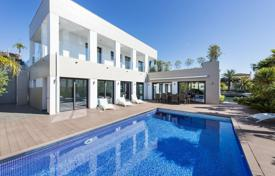 Luxury 5 bedroom houses for sale in Costa Brava. Modern villa with a swimming pool, terraces and a dock, on the channel of Santa Margarita, Roses, Spain