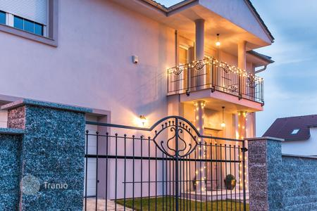 Houses with pools for sale in Prague. A new two-storey villa with a garden and a swimming pool in Prague