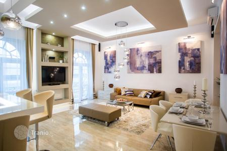 2 bedroom apartments for sale in Hungary. Furnished apartment with a balcony, a fireplace and a sauna, in a residence with an elevator, in the center of Budapest, Hungary