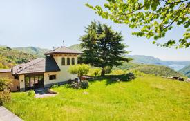 Luxury 5 bedroom houses for sale in Italian Lakes. Manor with a large plot of land with panoramic views of the mountains and Lake Como near Nesso, Lombardy, Italy