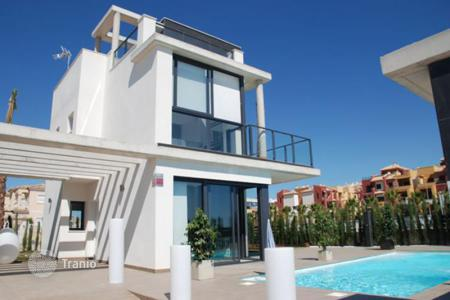4 bedroom houses for sale in Alicante. Villas with terraces and swimming pools in a new development, Orihuela Costa, Spain