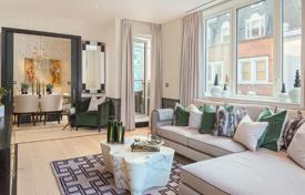 Luxury apartments for sale overseas. Two-level apartment with two terraces in a new residence with a concierge, a parking and a gym, London, UK