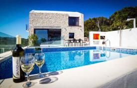 Modern villa with a plot, a garage, two swimming pools, a sauna and a sea view, Sutivan, Croatia for 520,000 €