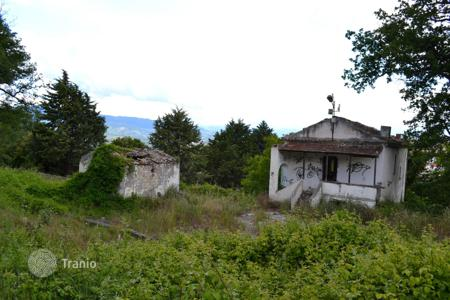 Cheap houses for sale in Italy. House to restore nestled in a wood