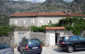 Houses for sale in Risan. Ancient stone cottage with three terraces and a view of Kotor Bay, on a plot with a parking, 200 meters from the sea, Risan, Kotor