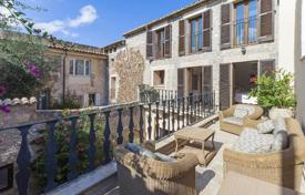 Townhouses for sale in Balearic Islands. Town house with mountain views in Pollensa, Mallorca, Spain