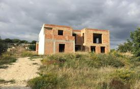 Coastal houses for sale in Sicily. Unfinished villa with a garden, a veranda and sea views, near the beach, Sampieri, Sicily, Italy