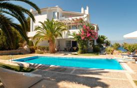 Houses for sale in Korinthos. Modern two-storey villa with pool and garden on the seafront in Corinthia, Peloponnese