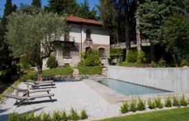 Luxury 5 bedroom houses for sale in Lombardy. Elegant historic villa with a century-old park and a lake view in Argegno, Lombardy, Italy