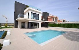 Coastal houses for sale in Spain. Designer villa with a private garden, a pool and a garage, Punta Prima, Spain