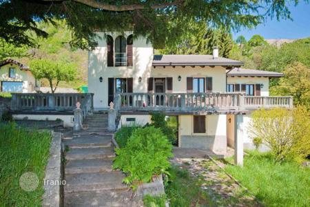 Luxury 4 bedroom houses for sale in Lombardy. Historic villa in a unique location in the town of Nesso, Italy