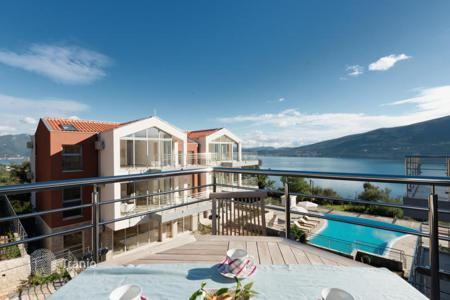 Apartments with pools for sale in Denovici. Apartment with terrace in a residential complex with a panoramic swimming pool and views of the Bay of Kotor, Djenovici, Montenegro