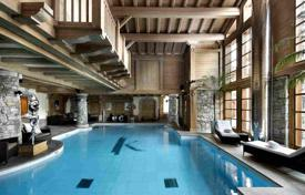 Villas and houses for rent with swimming pools in French Alps. New chalet with a swimming pool and spa area in a luxury ski resort of Courchevel 1850, France