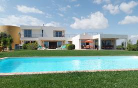 4 bedroom houses for sale in Faro. Restored Windmill attached to 2 Villas with 4 bedrooms and Sea Views, Olhão